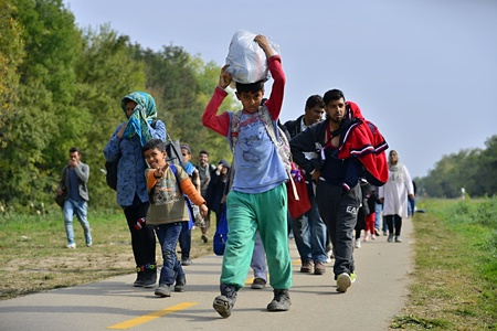 October 6,2015; Hegyeshalom in Hungary. Group of refugees leaving Hungary. They came to Hegyeshalom by train and then they leaving Hungary and go to Austria and then to Germany. Many of them escapes from home because of civil war.