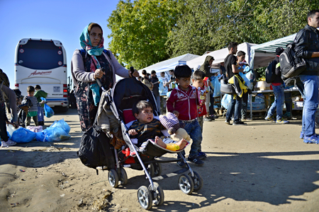 syrian civil war: October 4, 2015; Bapska in Serbia. Group of refugees leaving Serbia. They came to Bapska by buses and then they leaving Serbia and go to Croatia and then to Germany. Many of them escapes from home because of civil war.