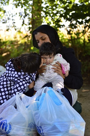 syrian war: October 4, 2015; Bapska in Serbia. Group of refugees leaving Serbia. They came to Bapska by buses and then they leaving Serbia and go to Croatia and then to Germany. Many of them escapes from home because of civil war.