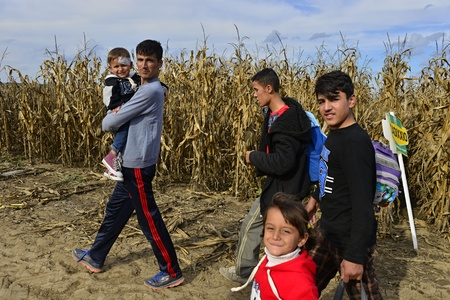 of boy and girl: October 4, 2015; Sid in Serbia. Group of Afghan refugees leaving Serbia. They came to Sid by taxi and then they leaving Serbia and go to Croatia and then to Germany. Many of them escapes from home because of civil war.