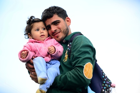 wojenne: October 6,2015; Hegyeshalom in Hungary. Group of refugees leaving Hungary. They came to Hegyeshalom by train and then they leaving Hungary and go to Austria and then to Germany. Many of them escapes from home because of civil war.