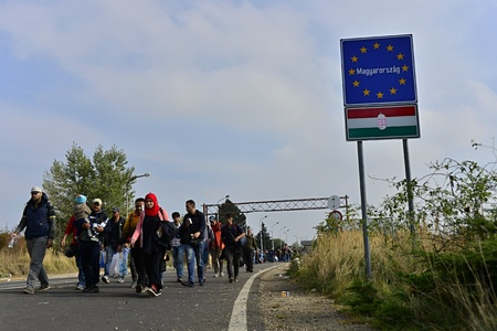 syrian civil war: October 6,2015; Hegyeshalom in Hungary. Group of refugees leaving Hungary. They came to Hegyeshalom by train and then they leaving Hungary and go to Austria and then to Germany. Many of them escapes from home because of civil war.