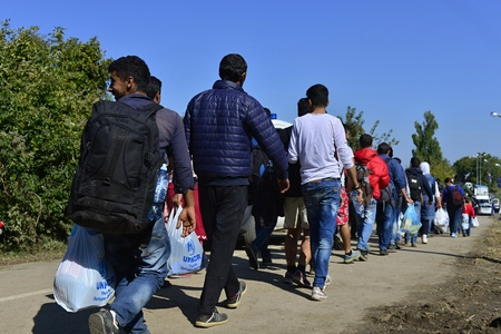 October 4, 2015; Bapska in Serbia. Group of refugees leaving Serbia. They came to Bapska be And Then They buses leaving Serbia and Croatia to go to Germany and Then. Many of Them escapes from home Because of civil war.
