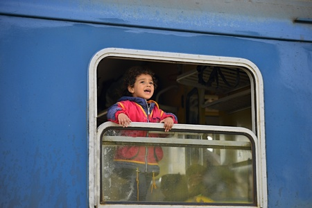October 6.2015; Hegyeshalom in Hungary. Group of refugees leaving Hungary. They came by train to Hegyeshalom And Then They go and leaving Hungary to Austria and Germany Then it. Many of Them escapes from home Because of civil war. Redakční