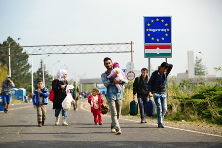 syrian civil war: October 6.2015; Hegyeshalom in Hungary. Group of refugees leaving Hungary. They came by train to Hegyeshalom And Then They go and leaving Hungary to Austria and Germany Then it. Many of Them escapes from home Because of civil war. Editorial