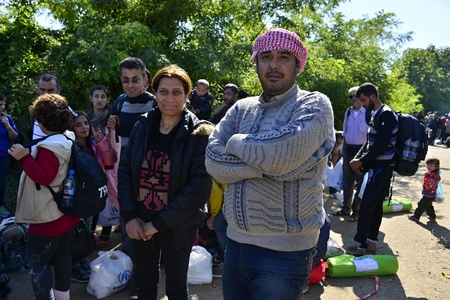 syrian civil war: October 4, 2015; Bapska in Serbia. Group of refugees leaving Serbia. They came to Bapska be And Then They buses leaving Serbia and Croatia to go to Germany and Then. Many of Them escapes from home Because of civil war.
