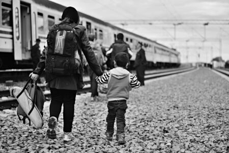 syrian civil war: October 5, 2015; Tovarnik in Croatia. Croatian police assist refugees get into train which will go to Hungary.
