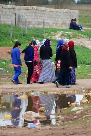 many children returning into Konbane with their parents. 3.4.2015, Kobane, Syria