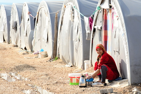 Syrian people in refugee camp in Suruc. These people are refugees from Kobane and escaped because of Islamic state attack. 3.4.2015, Suruc, Turkey