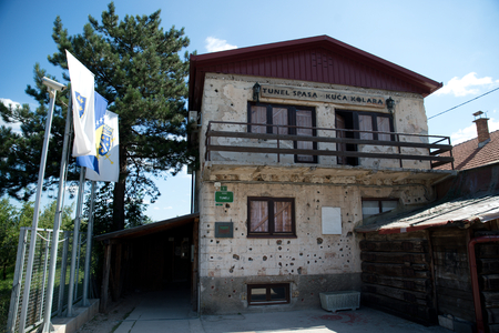 hercegovina: Sarajevo, Bosnia - July 7, 2016:The house through which Sarajevo Tunnel connected the city with other parts during the Siege of Sarajevo constructed in 1993. Note the bullet holes on walls. Editorial