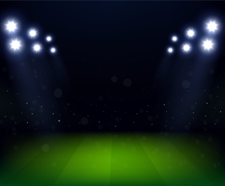 terrain foot: Stade de football dans la nuit avec projecteur