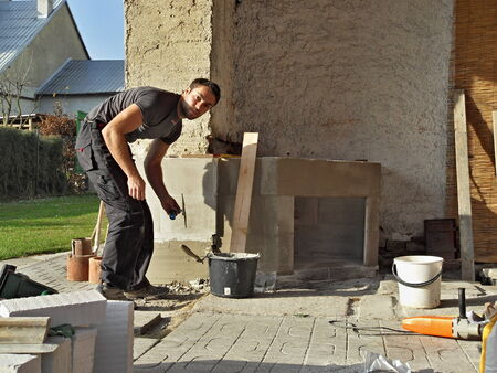 building an outdoor fireplace with smoke photo