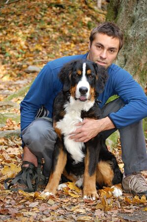 mature men: Young man with his dog in a hug.