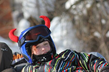 Beautiful snowboarder resting before riding.Photo taken on: 08022012