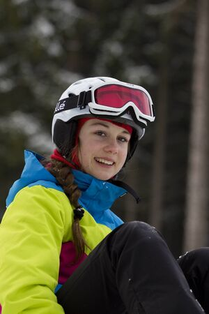 Beautiful snowboarder resting before riding.Photo taken on: 04022015