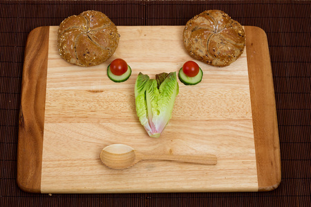 poised: Vegetable smiley poised for a healthy dinner Stock Photo