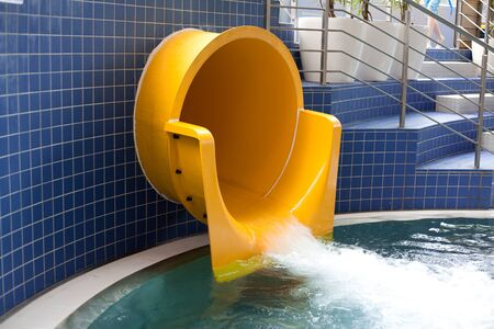 Closeup of the mouth of waterslide. photo