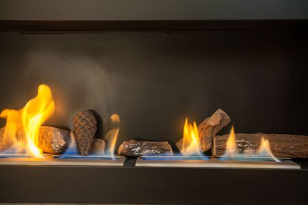 biofuel: Modern indoor fireplace on biofuel (closeup). Stock Photo