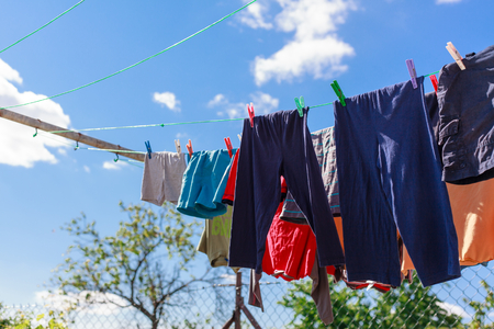 Drying clothing on the rope outside (Shallow DOF). Archivio Fotografico