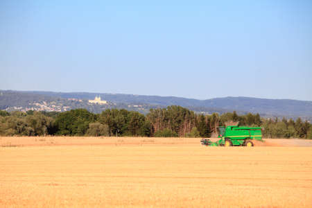 harvester: Combine harvester harvest field. Stock Photo