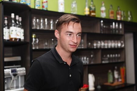 beer pump: The young barman serving behind the bar (the pumping device).