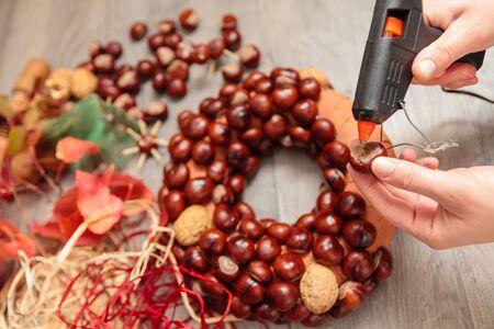 coronas navidenas: Handmade production of Christmas wreaths using weld gun (Shallow DOF).