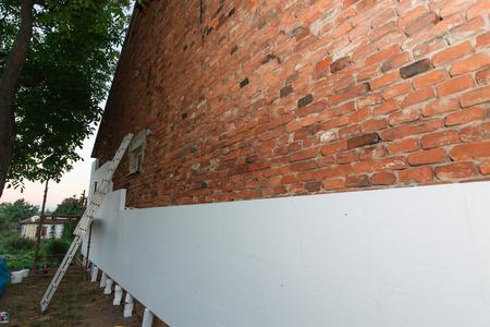 brick building: polystyrene insulation brick building (closeup; shallow DOF).