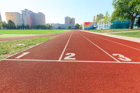 athletics track: numbered runway at an athletics track Stock Photo