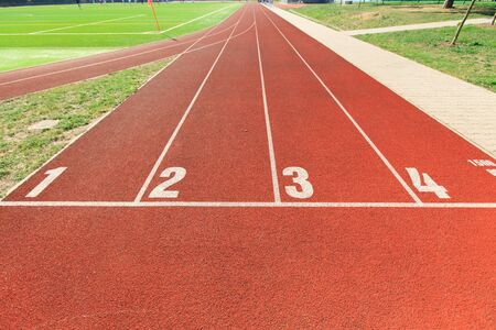 goal line: numbered runway at an athletics track Stock Photo