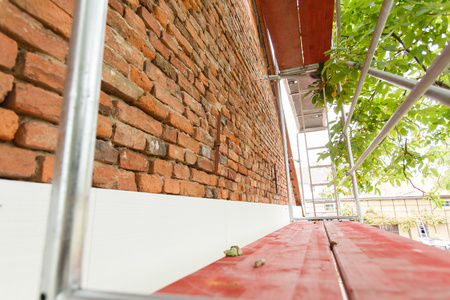scaling ladder: Reconstruction of the old house (insulation facade polystyrene). Stock Photo