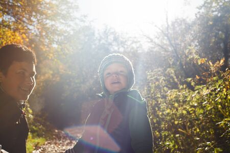 the sincerity: portrait of mother and son backlit autumn nature Stock Photo