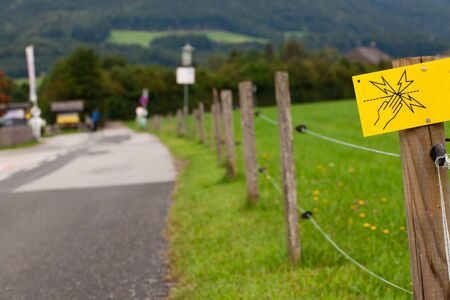 trespasser: Danger - Electric fence sign (Shallow DOF).