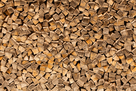 firewood: Chopped firewood, stacked and ready for winter. Stock Photo