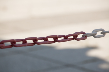 guarded: steel chain preventing access to the guarded site (Shallow DOF). Stock Photo