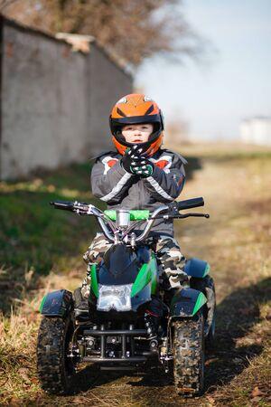 supercross: A little boy rides his electric ATV quad.