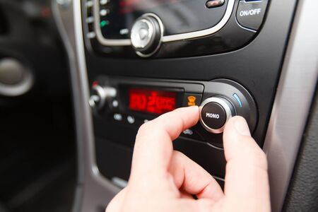 regulating: Adjusting the temperature in the car - climate control (Shallow DOF).