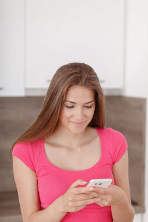 communicates: Beautiful young girl communicates using a a mobile phone. Depreciated on a message from her boyfriend.