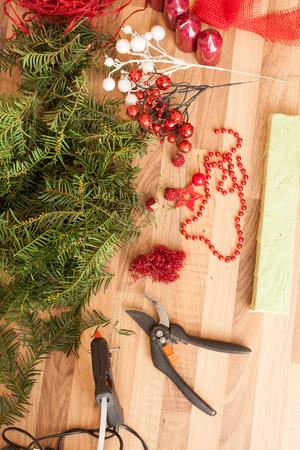 coronas de navidad: Handmade production of Christmas wreaths using weld gun (Shallow DOF).