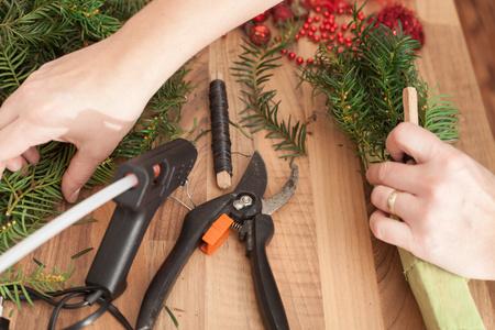 guirnaldas navideñas: Handmade production of Christmas wreaths using weld gun (Shallow DOF).
