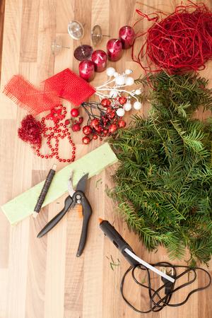 Handmade production of Christmas wreaths using weld gun (Shallow DOF).