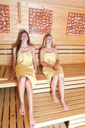 get together: Beautiful young girlfriends get together to use relaxation in the spa. A relaxing sauna bath.