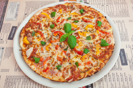 Pizza with salami and vegetables. (Color toned image) Stock Photo
