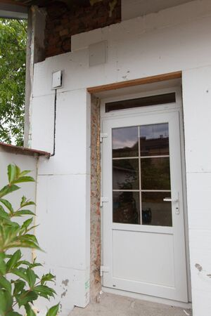 Reconstruction of the old house (insulation facade polystyrene). Foto de archivo