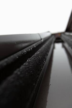Closeup of water drops on a skylight. Shallow DOF.