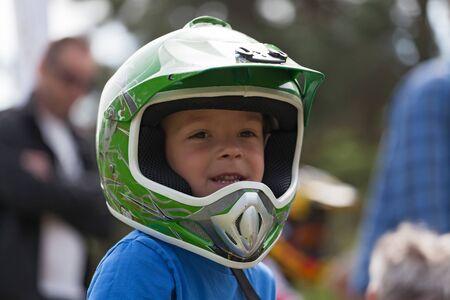 Little boy training on his bike.