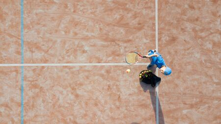 Little boy playing tennis. Tennis training for a child. Aerial view. Archivio Fotografico - 146462669