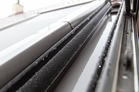 Closeup of water drops on a skylight. Shallow DOF. Archivio Fotografico - 146462677
