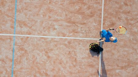 Little boy playing tennis. Tennis training for a child. Aerial view. Archivio Fotografico - 146462758