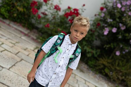 The little boy goes to school for the first time. Starting school. First grade of elementary school.