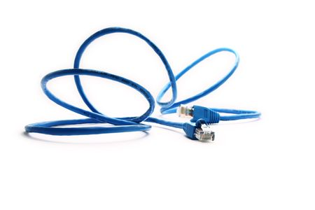 Closeup blue network cable over a white background